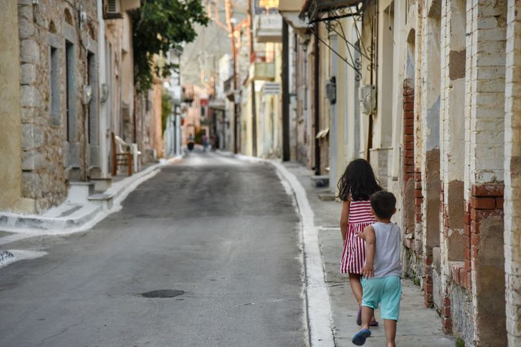 Summer Vacations Peaceful Outdoors Village Photography Village Life Streetphotography Building Exterior Architecture People Rear View Children Only From Where I Stand Localscene Childhood Narrow Street Malephotographerofthemonth Nikon D750 Nikon Photography Village Street Photography Capture The Moment - Greek Islands Chios Greece Connected By Travel