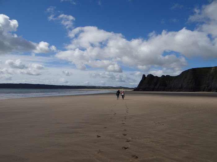 mother and son - walk on the beach Betterlandscapes Three Cliffs Bay Beach Beauty In Nature Cloud - Sky Day Full Length Gowerpeninsula Horizon Over Water Nature One Person Outdoors Oxwichbay People Real People Sand Scenics Sea Sky Tranquil Scene Tranquility Vacations Water