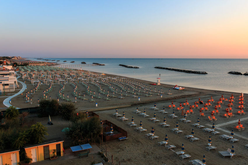 The morning on the beach of Torre Pedrera at Rimini in Italy Water Sea High Angle View Architecture Sky Horizon Nature Horizon Over Water Sunset Beach Building Exterior Beauty In Nature Transportation Land Built Structure Group Of People City Clear Sky Chair Torre Pedrera Adriatic Sea Sunrise Sandy Beach Beach Lounger Seaside Resort