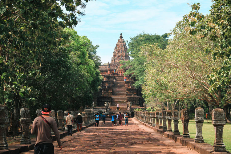 people walking to Khao Phanom Rung Castle Castle Thailnad Ancient Ancient Civilization Architecture Building Exterior Built Structure Day History Men Nature Outdoors People Place Of Worship Real People Religion Sky Spirituality Statue Travel Destinations Tree