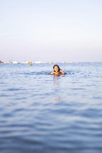 Portrait of girl swimming in sea