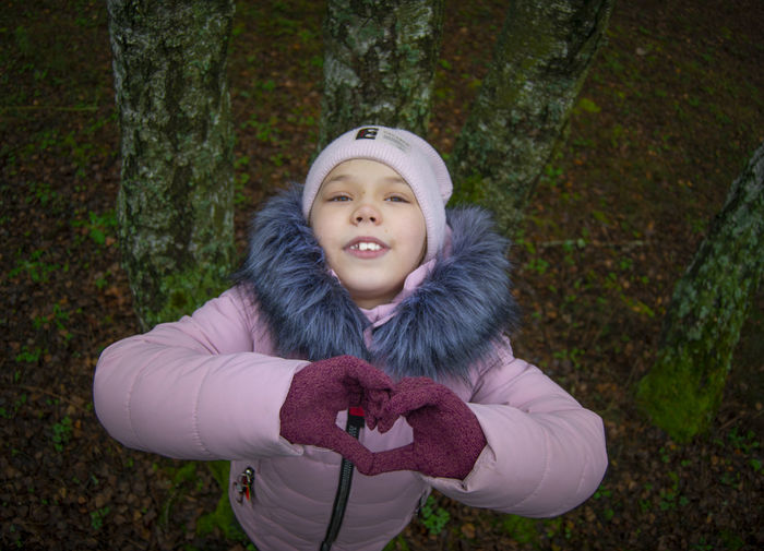 Portrait of cute girl in forest