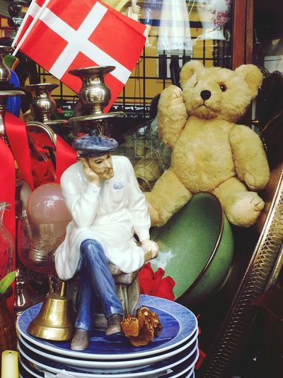 Fleamarket For Sale Market Indoors  Flea Market FleaMarketTreasure Antiques Losttreasure Treasure Figurines  Bricabrac Trinkets Forgottenspaces Forgotten Places  Statue Plates Stacked Teddy Bear Teddy Lost And Found Indoors  No People Focus On Foreground Flags Denmark Close-up