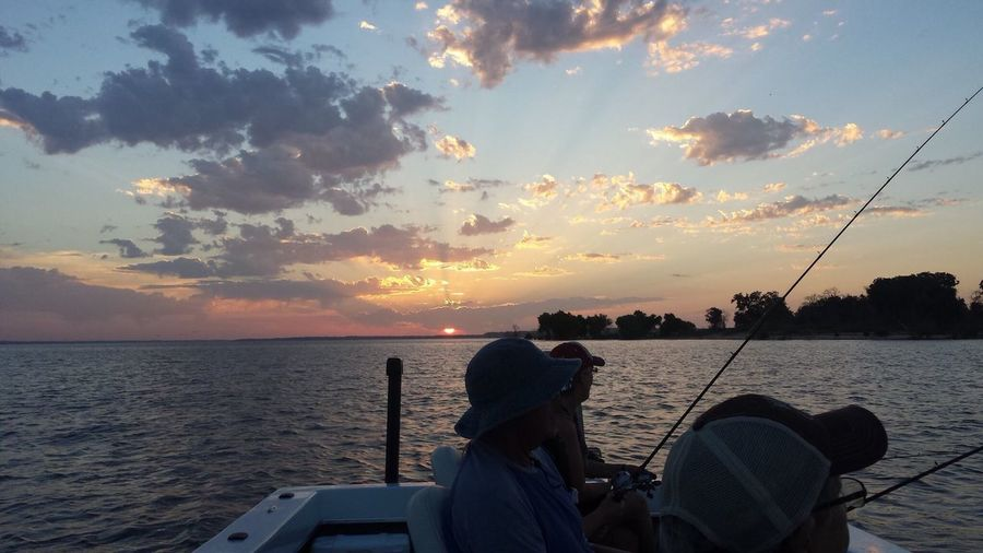Sunset On The Lake. Fishermen on a boat. Texas Skies Fishing Rod Sunset Sunset Silhouettes Horizon Over Water Outdoors Fishing Rod Men Rear View Beauty In Nature Dramatic Sky Leisure Activity Scenics - Nature Texas Fisherman Fishing Rod Lake Relaxation Silhouette Summer Fishing Hook Fisherman Boat Dusk Copy Space It's About The Journey