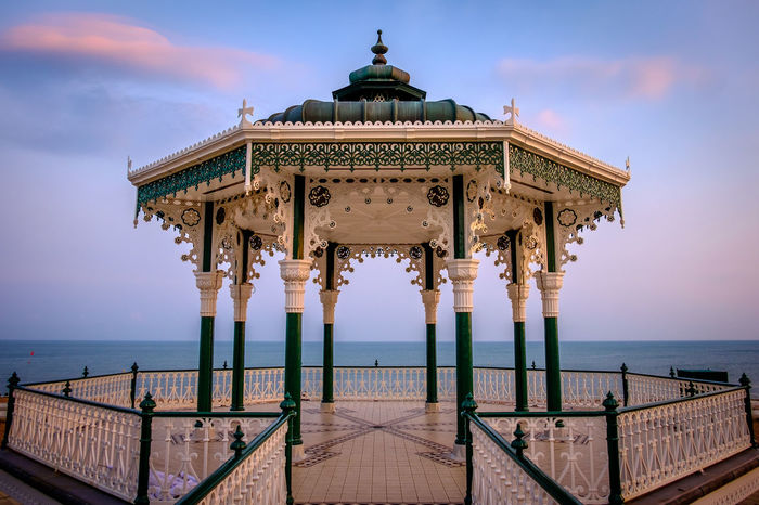 Brighton's Band Stand at sunset Brighton Brighton Beach Architectural Column Architecture Band Stand Building Exterior Built Structure Cloud - Sky Horizon Over Water No People Outdoors Railing Scenics Sea Sky Sunset Travel Destinations Water