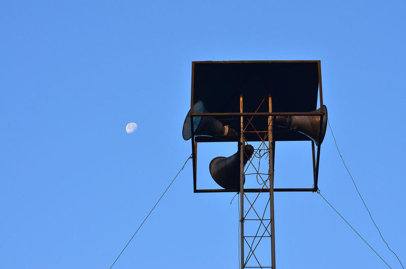 Low angle view of megaphone on power line