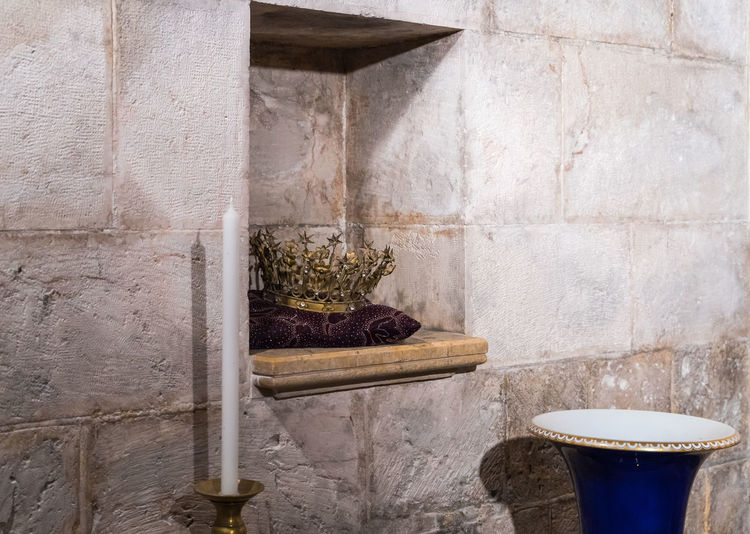 Jerusalem, Israel, March 09, 2019 : The crown lies on a pillow in a niche in the wall in the prayer hall in the cave in the Church of Saint Anne in the old city of Jerusalem, Israel Tank Roman Cistern Heritage Historic Brick Wall Stone Material Damaged Arch Remains Landmark Ruins Christianity Excavations Scenic View Ancient Archaeological Religion And Beliefs Culture Antique Architecture Jerusalem Israel Old City Church Of Saint Anne And The Pools Of Bethesda Worship