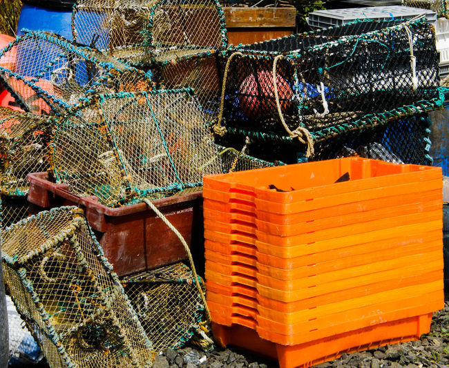 Crab Pots Day Fishing Gear Fishing Tackle Harbour Side Isle Of Skye Lobster Pots No People Outdoors Scotland Stein Stein Jetty Fish Crates Orange Fish Crates