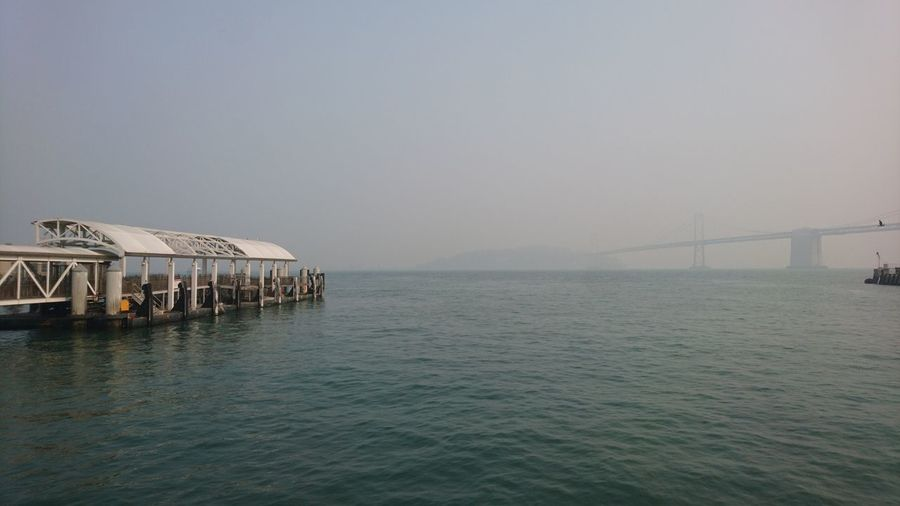 View of bridge over sea against clear sky