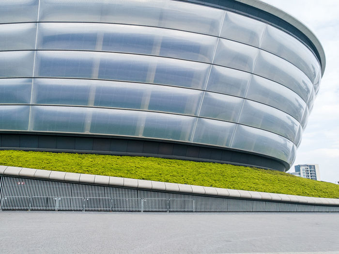 Glasgow  GLASGOW CITY Seec Hydro Building Architecture Curves Wavy Steel Futuristic Envision The Future Day Outdoors Tower Block  Old And New Grass Fence Steel Structure  Modern Stadium Arena Hydro Music Venue Metal Metallic Your Design Story