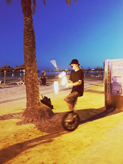 Clear Sky One Person Real People Outdoors Sky Unicycle Tricks Unicycle Fire Juggling Juggler Beach