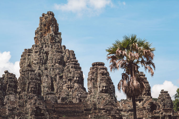 Siem Reap Cambodia Angkor History Sky The Past Built Structure Architecture Low Angle View Travel Travel Destinations Ancient Religion Place Of Worship Nature Spirituality Tourism Belief Tree Old Ruin Day Palm Tree No People Ancient Civilization Outdoors Ruined Archaeology
