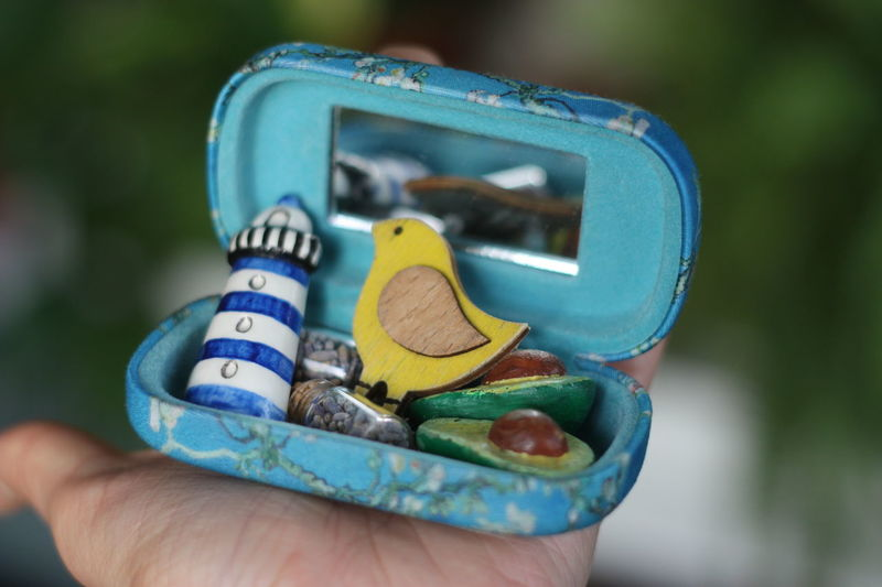 Brooch Earrings Lighthouse Mirror Avocado Bird Brooches Close-up Cosmetic Bag Day Flowering Almond Flowering Almond Tree Focus On Foreground Holding Human Body Part Human Finger Human Hand Lavander Turquoise Van Gogh Van Gogh Inspiration