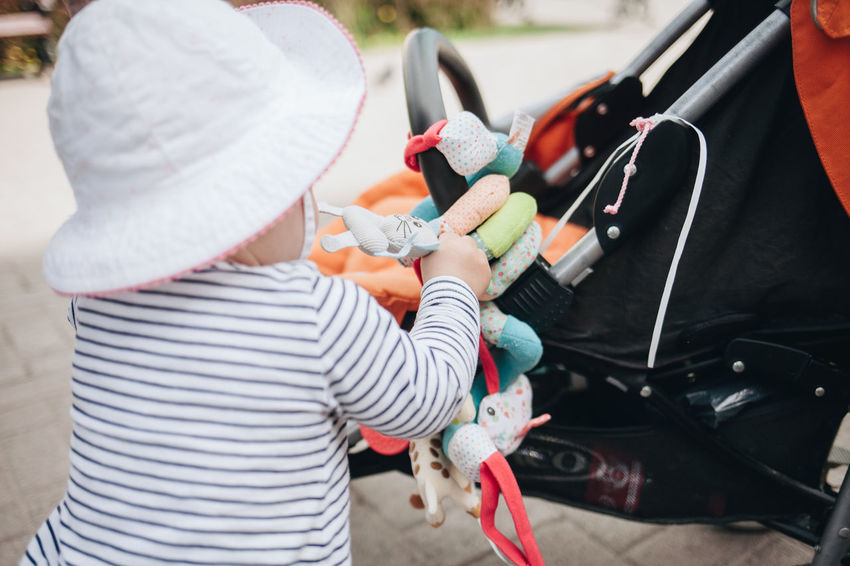 Child Baby Stroller Casual Clothing Child Childhood Day Holding Lifestyles One Person Outdoors Real People Rear View Sun Hat