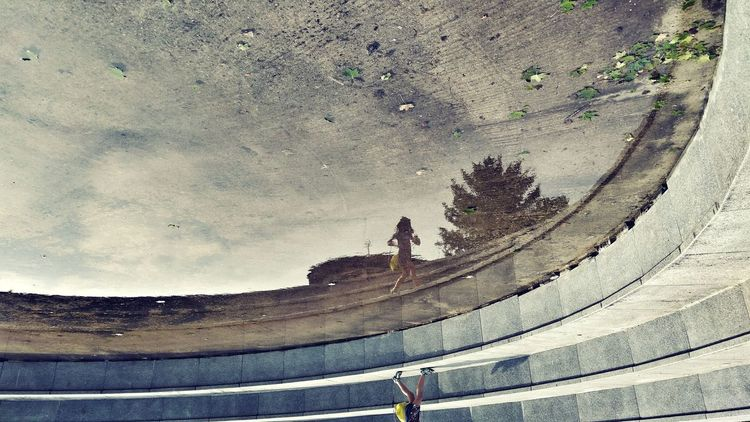 Urbanphotography Urban Geometry Reflection Fountain Girl Walking Around Real People Upside Down City Silhouette Sky
