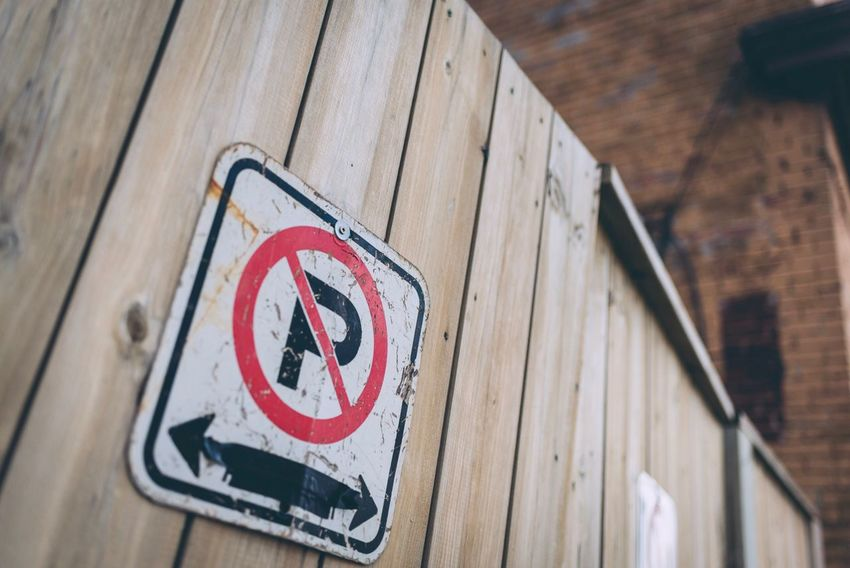 Fence Tow Away Zone No Parking Sign Communication Warning Sign Day No People Low Angle View Close-up Road Sign Outdoors