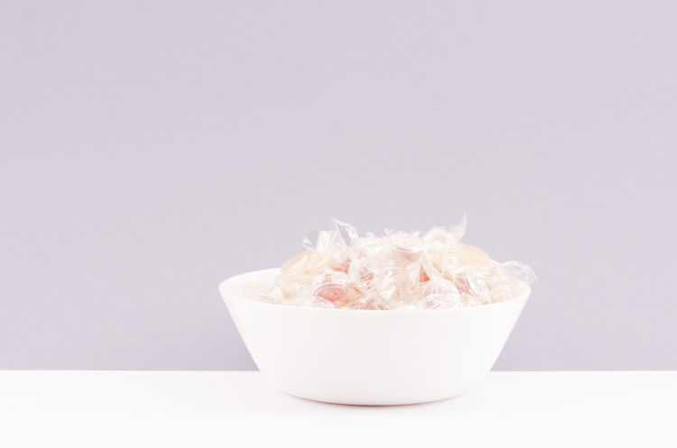 temptations Studio Shot Indoors  Copy Space Food And Drink Food Cut Out Still Life Freshness Close-up No People White Background Bowl Pink Color White Color Popcorn Sweet Food Unhealthy Eating Wellbeing Container Single Object Snack