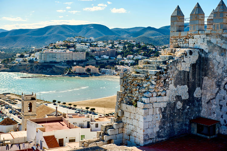 Castillo de peniscola against by sea during sunny day