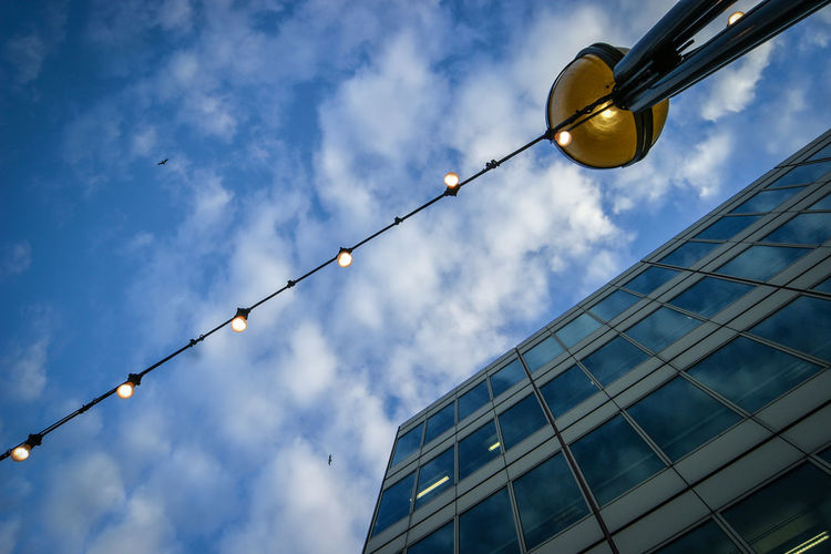 Sky Low Angle View Cloud - Sky Building Exterior No People Architecture Built Structure City Lighting Equipment Blue Street Light Day Street Cable Outdoors Dusk Building Glass - Material Office Building Exterior Modern Electricity  Directly Below Electric Lamp England LINE