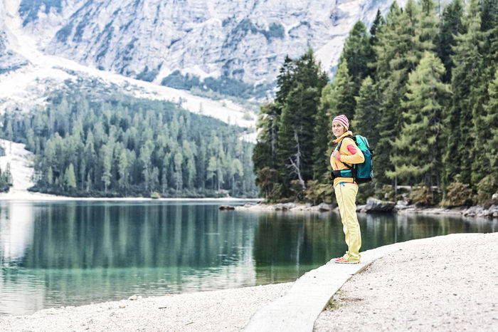 Woman hiking at the lake Alps Alto Adige Braies Braies Lake Bruneck Enjoy Girl Hike Hiker Hiking Holiday Lake Leisure Activity Mountain Mountains Nature Outdoors Prags Pragser Wildsee Recreation  Scenics Single Südtirol Walking Woman