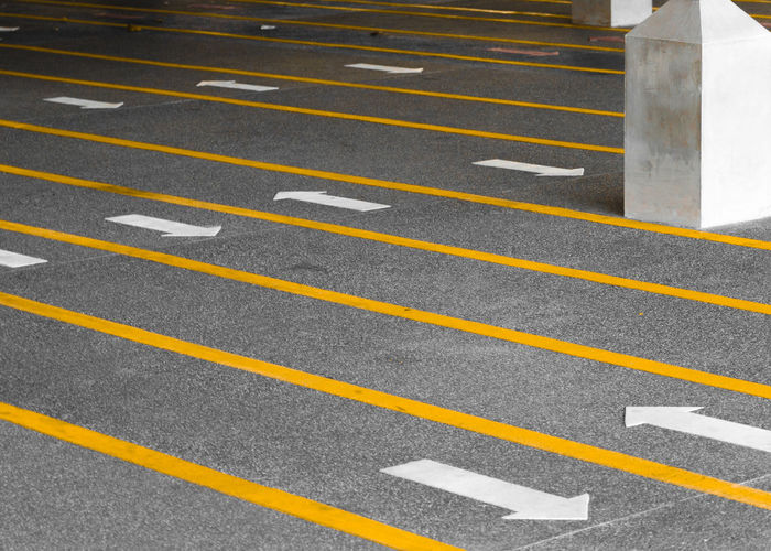 Arrows Asphalt City Column Contrast Day Dividing Line Floor Patterns No People Outdoors Pattern Road Sport Sports Race Striped Transportation Waiting Lines Yellow