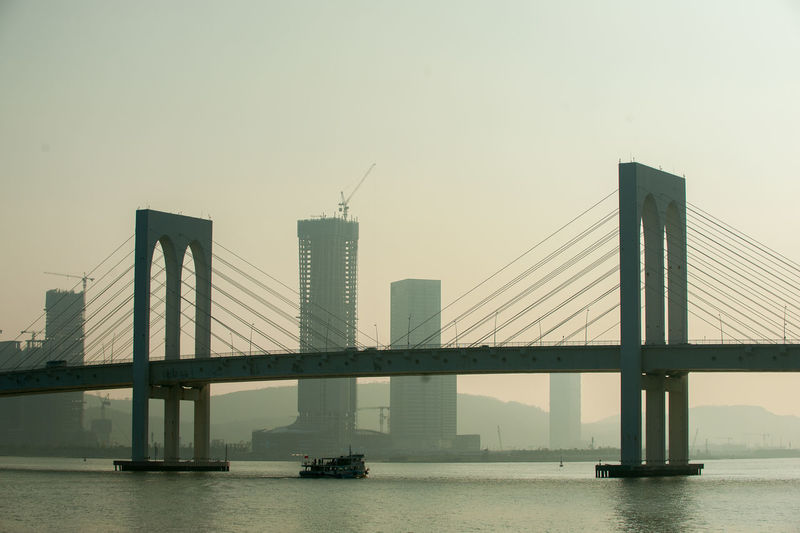 Architecture Bridge Bridge - Man Made Structure Built Structure City Connection Day Engineering Fog Macau Macau Bridge No People Outdoors River Sky Suspension Bridge Transportation Travel Travel Destinations Water Waterfront