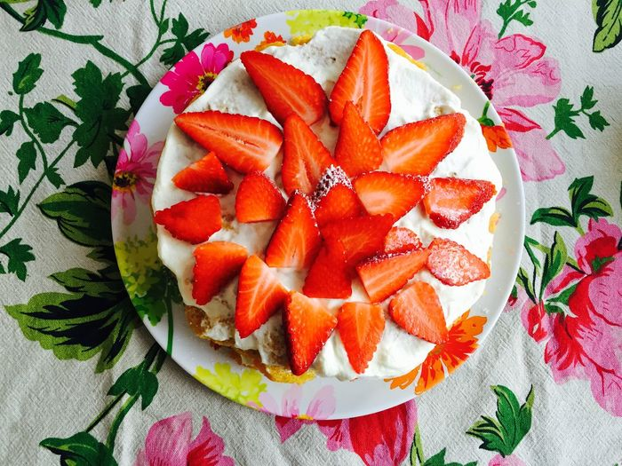 Directly above shot of strawberry cake in plate on table