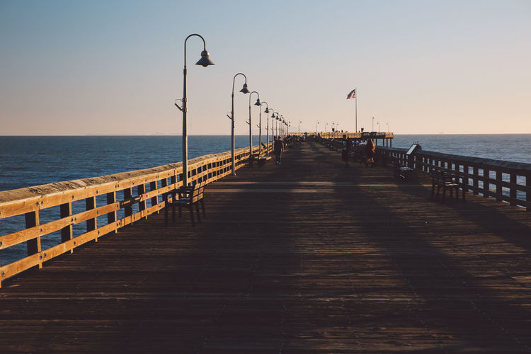 California Ventura Pier Beach Beauty In Nature Clear Sky Day Horizon Over Water Nature No People Outdoors Pier Railing Scenics Sea Sky Sunset The Way Forward Tranquil Scene Tranquility Water Wood Paneling