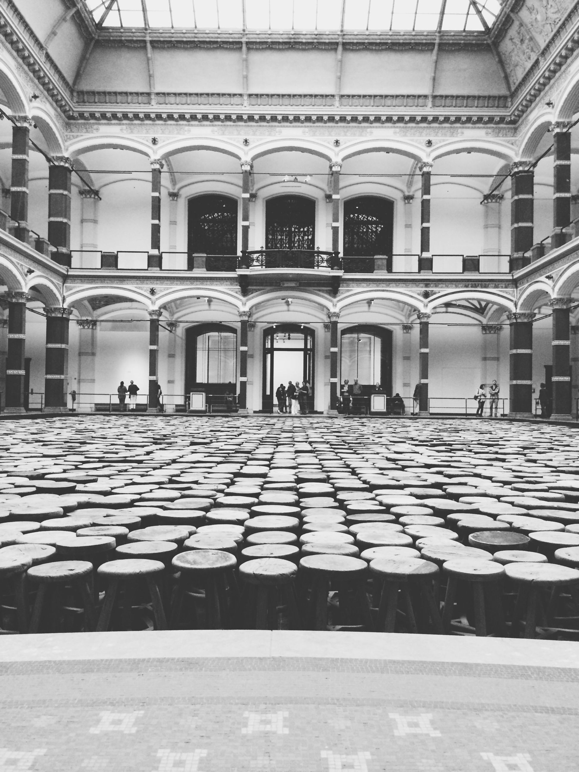 architecture, built structure, building exterior, arch, window, building, in a row, architectural column, indoors, incidental people, empty, day, facade, flooring, architectural feature, cobblestone, sunlight, repetition, city, no people