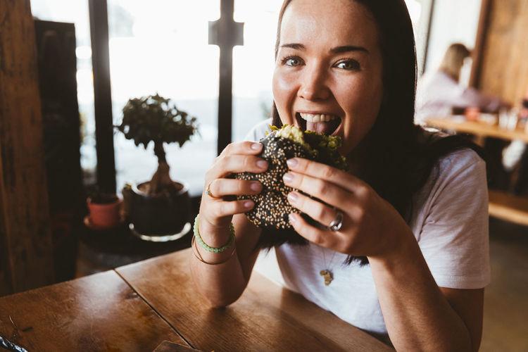 Burger Eating Fast Food Food And Drink Happy Woman Food Hamburger Smiling Vegan