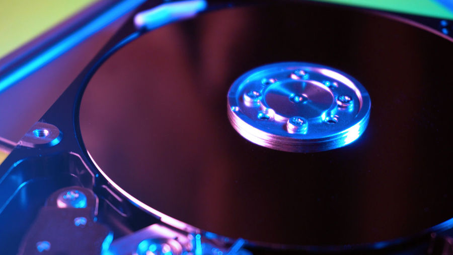 Close up view of hard drive Technology Close-up Music Arts Culture And Entertainment Equipment No People Indoors  Record Blue Focus On Foreground Audio Equipment High Angle View Turntable Retro Styled Control Musical Equipment Musical Instrument Communication Compact Disc Nightlife Electrical Equipment
