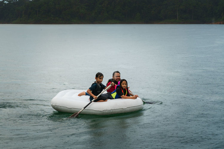 High angel view of family in boat at lake