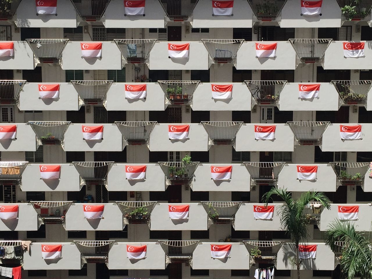 Full frame shot of singaporean flags on building balconies