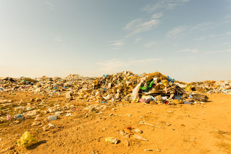 Garbage on sand at beach against sky