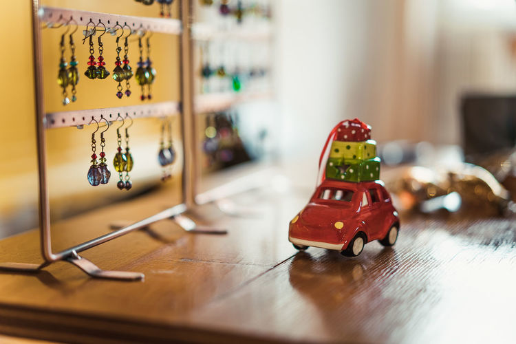 Christmas Decoration Christmas Decoration Christmas Festive Decoration Indoors  Selective Focus Table Wood - Material Toy Still Life No People Toy Car Close-up Large Group Of Objects Flooring Home Interior Plastic Representation Key Car Focus On Foreground Text Choice