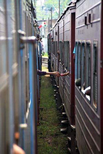Cropped Image Of People Shaking Hands While Traveling In Trains
