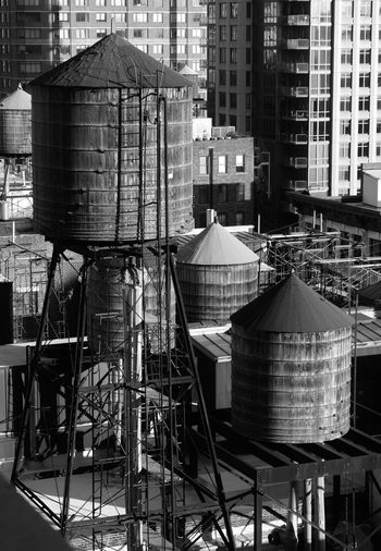 High Angle View Of Silos Against Built Structures