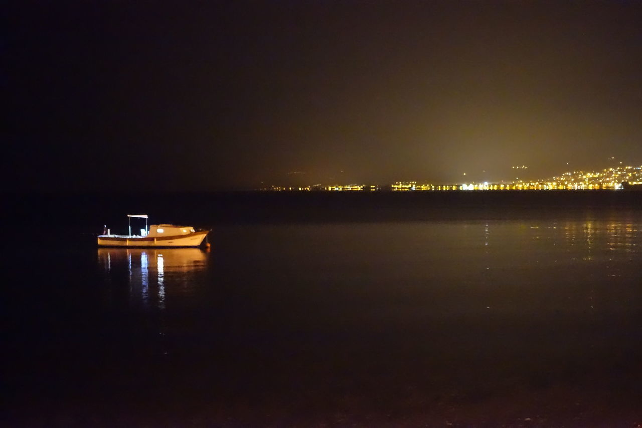 water, night, nautical vessel, illuminated, reflection, transportation, sea, waterfront, mode of transport, no people, tranquility, outdoors, sky, nature, scenics, beauty in nature, sailing, architecture, yacht, city