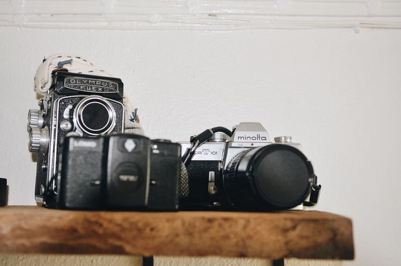 Cafe Camera - Photographic Equipment Photography Themes Photographic Equipment Retro Styled Technology Indoors  No People Still Life Close-up Camera Wall - Building Feature Photographing Studio Shot Nostalgia Antique Digital Camera Vintage Lens - Optical Instrument SLR Camera