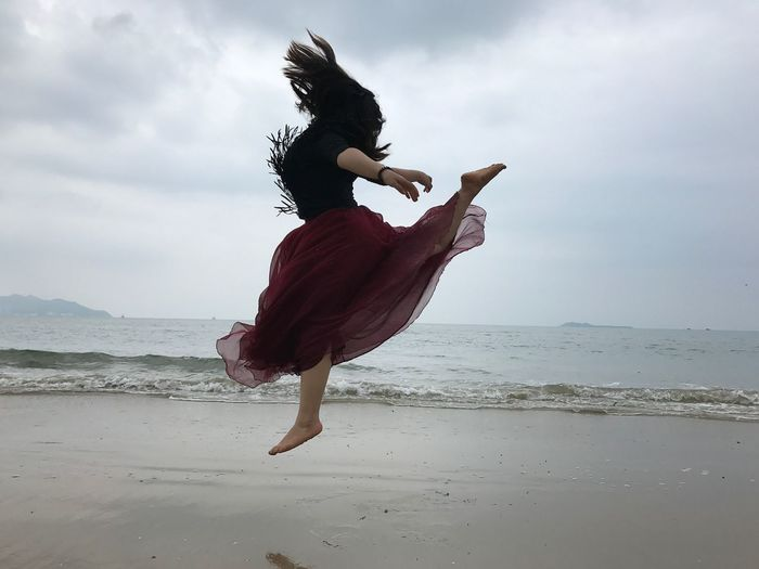 Jumping by the seaside 2 Beach Sky Sea One Person Full Length Land Cloud - Sky Real People Horizon Over Water Nature Freedom Water Leisure Activity Dancing Motion Young Adult Dress Lifestyles Women Adult
