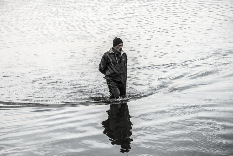 Mature Man Walking In Lake