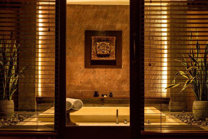 Hot tub in hotel seen through door