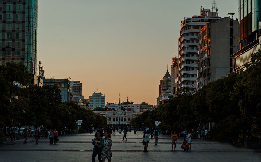 People in city at sunset