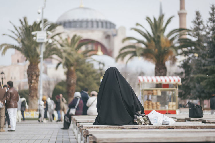 Burka  City City Life Lifestyles Mosque Outdoors Palm Trees Palmtree Sitting Tourism Tourist Travel Travel Destinations Travel Photography Traveling Waiting Women