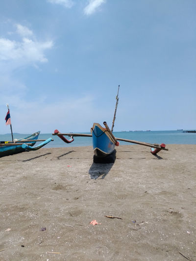 Flower Boats River Sea And Sky INDONESIA Cilacap Nelayan Fish Fishing Central Java Sea Beach Two People Water Nautical Vessel Outdoors Sand Day Sky Horizon Over Water Adults Only Adult Blue Cloud - Sky People Fisherman Full Length Nature Working Only Women