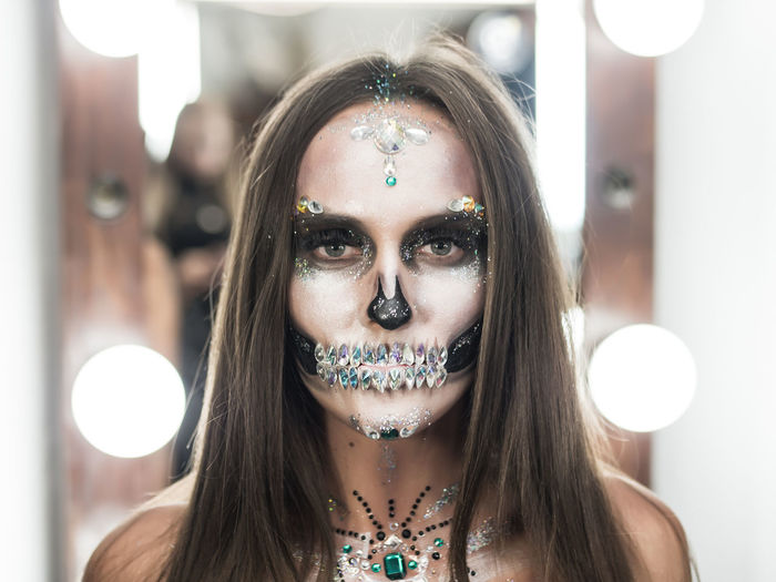 Close-Up Portrait Of Young Woman With Spooky Face Paint