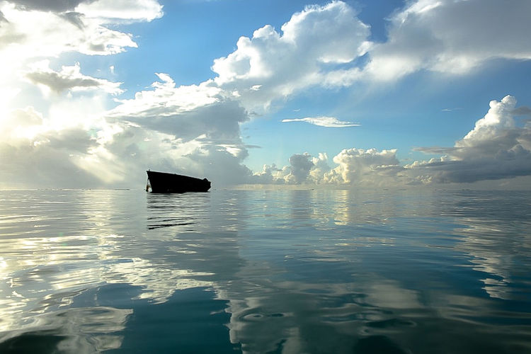 Water Cloud - Sky Sky Reflection Waterfront Sea Tranquility Scenics - Nature Nature Tranquil Scene Beauty In Nature Day No People Outdoors Sunlight Idyllic Nautical Vessel Transportation Non-urban Scene Mauritius Indian Ocean
