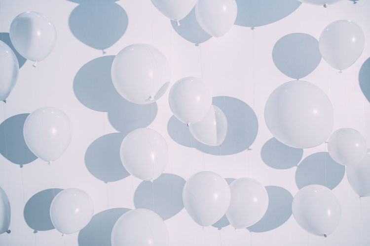 Full frame shot of balloons against white background