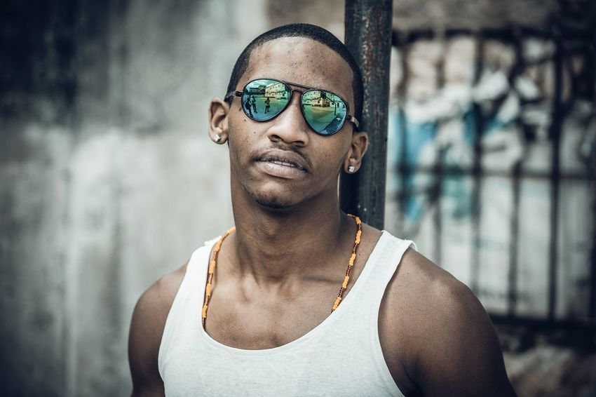 Street portrait in Havana Cuba Retro People Storytelling Travel Cuba Havana Streetphotography Glasses Portrait Headshot Young Adult One Person Focus On Foreground Sunglasses Real People