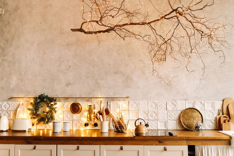 The interior of a christmas decorated kitchen in the loft style in a cozy house